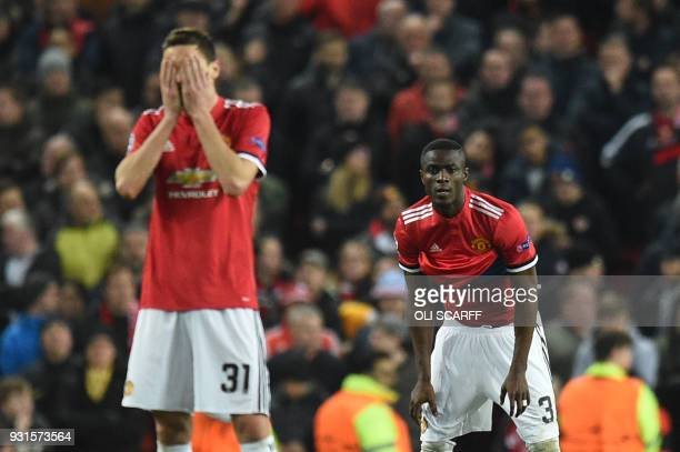 TOPSHOT Manchester United's Serbian midfielder Nemanja Matic and Manchester United's Ivorian defender Eric Bailly react after Sevilla scored their...