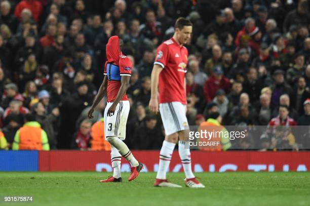 Manchester United's Serbian midfielder Nemanja Matic and Manchester United's Ivorian defender Eric Bailly react after Sevilla scored their second...