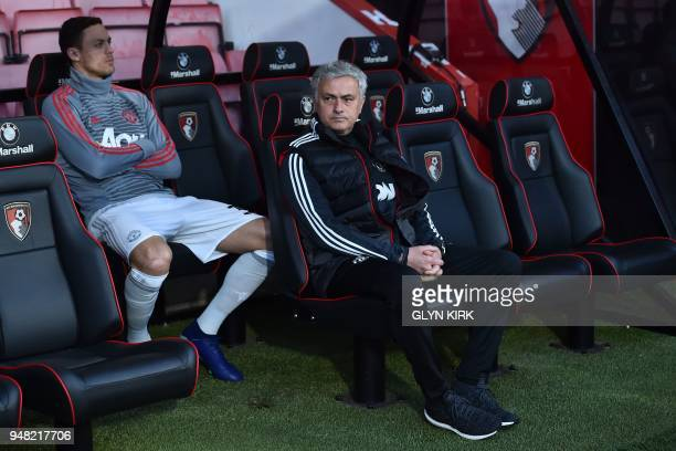 Manchester United's Serbian midfielder Nemanja Matic and Manchester United's Portuguese manager Jose Mourinho await kick off in the English Premier...