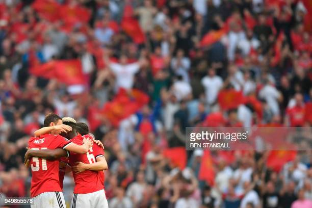 Manchester United's Serbian midfielder Nemanja Matic and Manchester United's French midfielder Paul Pogba embrace at the end of the English FA Cup...