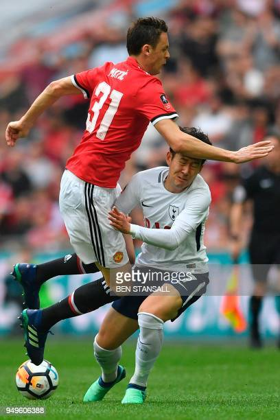 Manchester United's Serbian midfielder Nemanja Matic battles with Tottenham Hotspur's South Korean striker Son HeungMin during the English FA Cup...