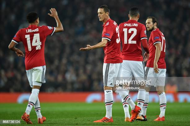 Manchester United's Serbian midfielder Nemanja Matic celebrates his part in the opening goal with teammates during the UEFA Champions League Group A...