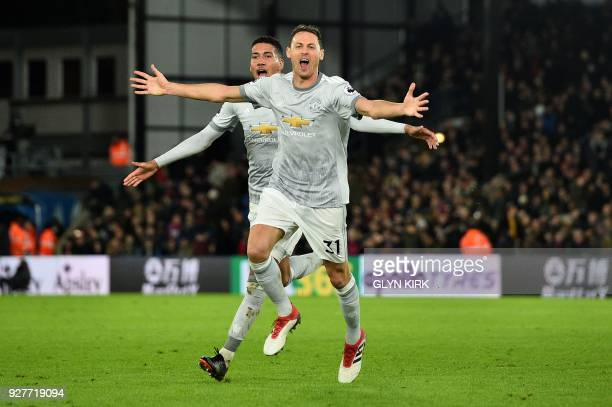 Manchester United's Serbian midfielder Nemanja Matic celebrates scoring his team's third goal during the English Premier League football match...