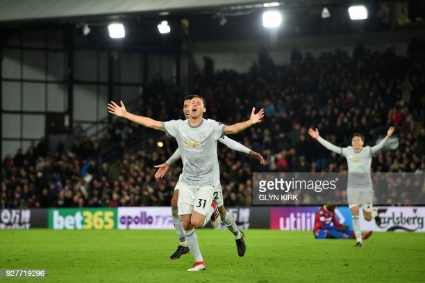 Manchester United's Serbian midfielder Nemanja Matic celebrates scoring his team's third goal during the English Premier League football match...