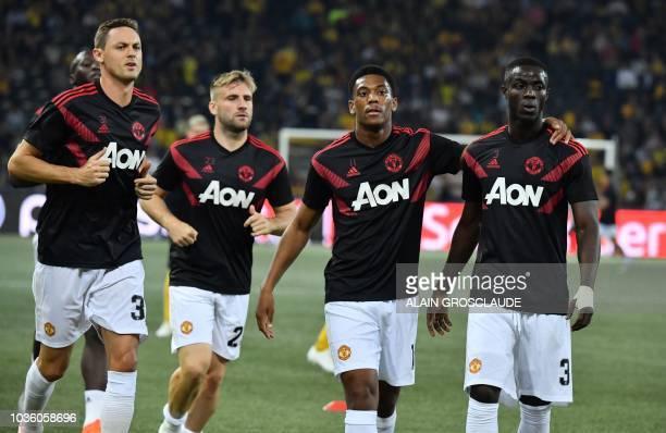 Manchester United's Serbian midfielder Nemanja Matic Swedish defender Victor Lindelof French striker Anthony Martial and Manchester United's Ivorian...