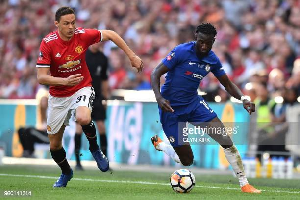 Manchester United's Serbian midfielder Nemanja Matic vies with Chelsea's French midfielder Tiemoue Bakayoko during the English FA Cup final football...