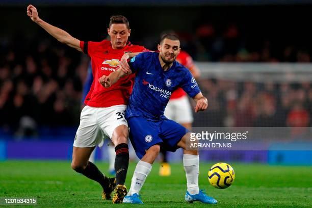 Manchester United's Serbian midfielder Nemanja Matic vies with Chelsea's Croatian midfielder Mateo Kovacic during the English Premier League football...