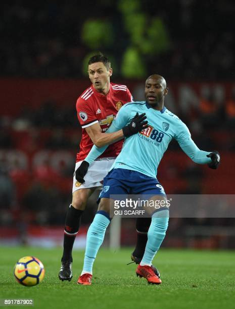 Manchester United's Serbian midfielder Nemanja Matic vies with Bournemouth's English striker Benik Afobe during the English Premier League football...