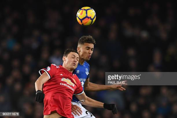 Manchester United's Serbian midfielder Nemanja Matic vies with Everton's English striker Dominic CalvertLewin during the English Premier League...