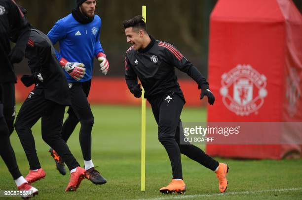Manchester United's Spanish goalkeeper David de Gea and Manchester United's Chilean striker Alexis Sanchez attends a team training session at the...