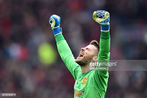 Manchester United's Spanish goalkeeper David de Gea celebrates after Manchester United's French striker Anthony Martial scored their second goal...