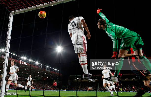 Manchester United's Spanish goalkeeper David de Gea clashes with Manchester United's French striker Anthony Martial as he attempts to save a corner...