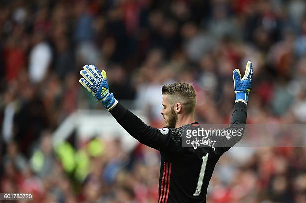 Manchester United's Spanish goalkeeper David de Gea gestures during the English Premier League football match between Manchester United and...