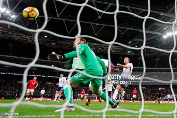 Manchester United's Spanish goalkeeper David de Gea looks on as Manchester United's English defender Phil Jones scores an own goal to make the score...
