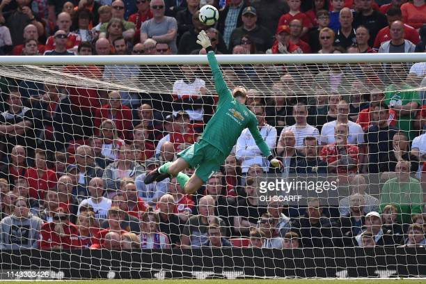 TOPSHOT Manchester United's Spanish goalkeeper David de Gea makes a save during the English Premier League football match between Manchester United...