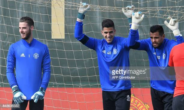 Manchester United's Spanish goalkeeper David de Gea Manchester United's Portuguese goalkeeper Joel Castro Pereira and Manchester United's Argentinian...