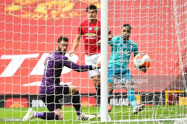 Manchester United's Spanish goalkeeper David de Gea reacts as he Bournemouth's English midfielder Junior Stanislas shoots past him and scores during...