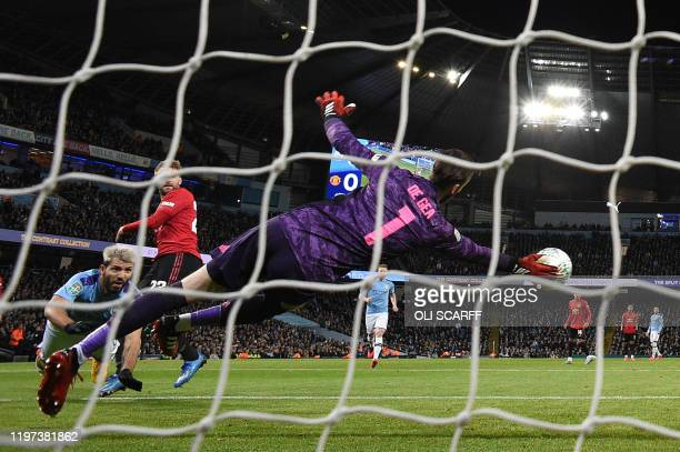 Manchester United's Spanish goalkeeper David de Gea saves a shot from Manchester City's Argentinian striker Sergio Aguero during the English League...