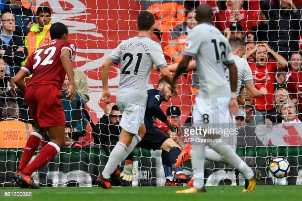 Manchester United's Spanish goalkeeper David de Gea saves a shot from Liverpool's Cameroonian defender Joel Matip during the English Premier League...
