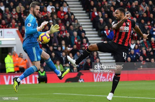 TOPSHOT Manchester United's Spanish goalkeeper David de Gea saves an attempt from Bournemouth's English striker Callum Wilson during the English...