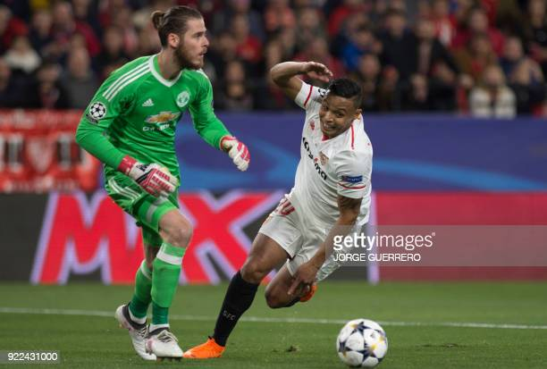 Manchester United's Spanish goalkeeper David De Gea vies with Sevilla's Colombian forward Luis Muriel during the UEFA Champions League round of 16...