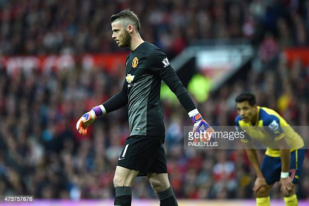 Manchester United's Spanish goalkeeper David de Gea walks off the pitch after being injured during the English Premier League football match between...