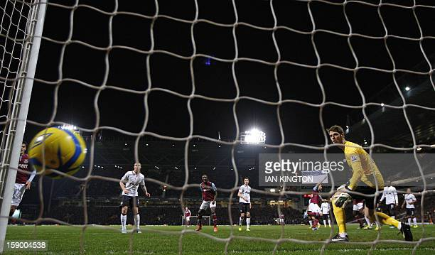 Manchester United's Spanish goalkeeper David De Gea watches as West Ham United's Welsh defender James Collins scores his goal during the English FA...