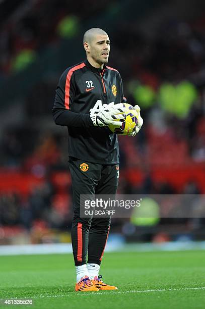 Manchester United's Spanish goalkeeper Víctor Valdes warms up ahead of the English Premier League football match between Manchester United and...