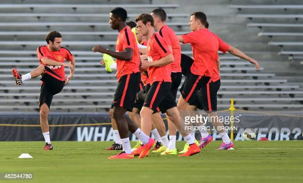 Manchester United's Spanish international Juan Mata and teammates perform drills during a training session at the Rose Bowl in Pasadena California on...