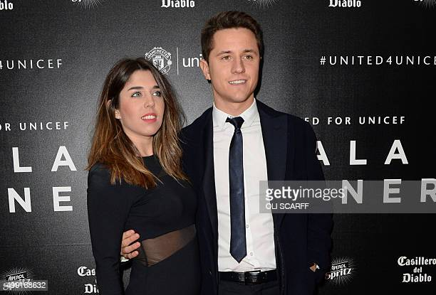 Manchester United's Spanish midfielder Ander Herrera and his girlfriend Isabel Collado pose for pictures on the red carpet as they arrive to attend...