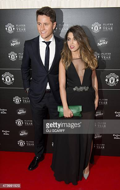 Manchester United's Spanish midfielder Ander Herrera and his partner Isabel Collado pose for pictures on the red carpet as they arrive to attend the...