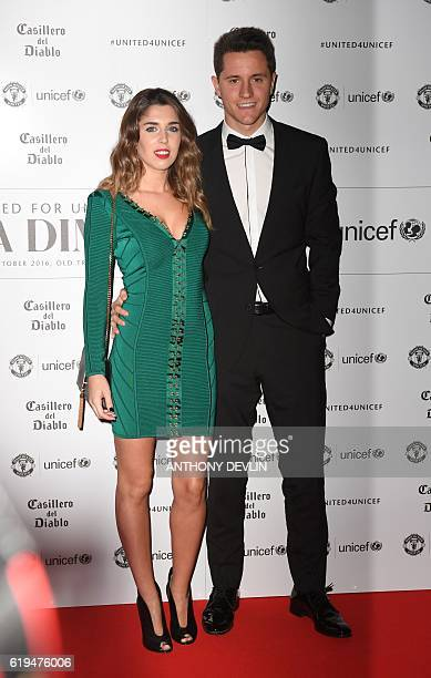 Manchester United's Spanish midfielder Ander Herrera and partner Isabel Collado pose on the red carpet as they arrive to attend the United for UNICEF...