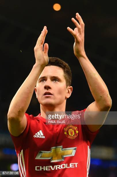 Manchester United's Spanish midfielder Ander Herrera applauds their fans at the end of the English Premier League football match between Manchester...