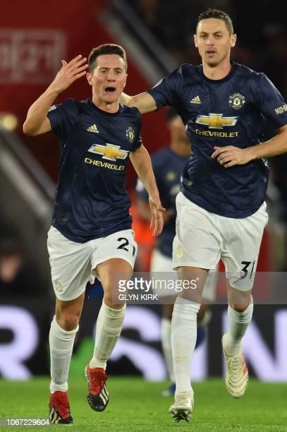 Manchester United's Spanish midfielder Ander Herrera celebrates scoring their second goal to equalise 22 with Manchester United's Serbian midfielder...