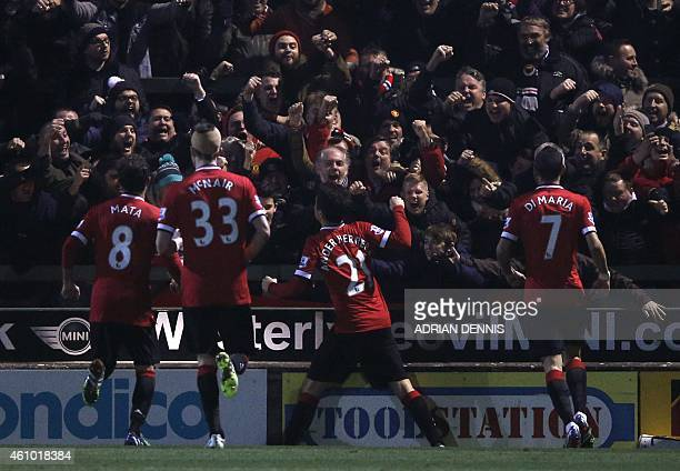 Manchester United's Spanish midfielder Ander Herrera celebrates scoring their first goal during the English FA Cup third round football match between...