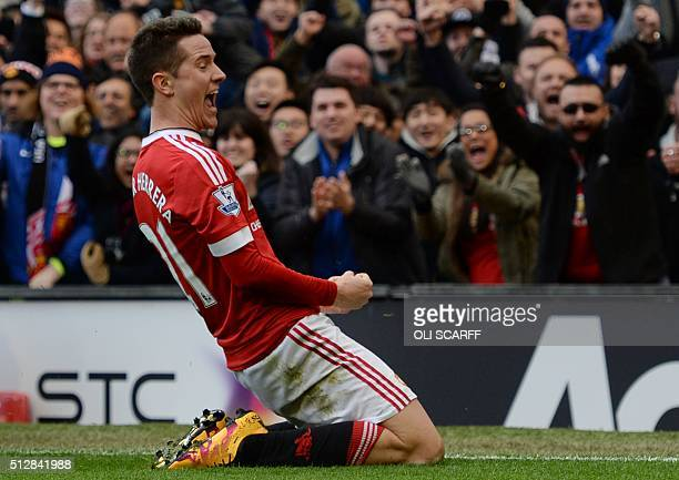 Manchester United's Spanish midfielder Ander Herrera celebrates scoring their third goal during the English Premier League football match between...