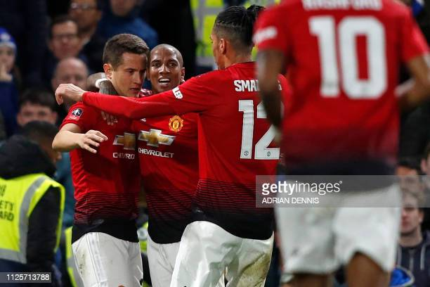 Manchester United's Spanish midfielder Ander Herrera celebrates with teammates after scoring the opening goal of the English FA Cup fifth round...