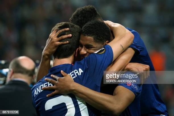 Manchester United's Spanish midfielder Ander Herrera celebrates with Manchester United's English striker Marcus Rashford after the UEFA Europa League...