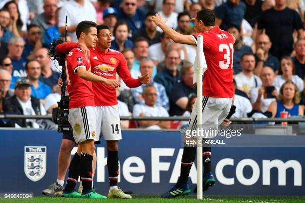 Manchester United's Spanish midfielder Ander Herrera celebrates with Manchester United's English midfielder Jesse Lingard and Manchester United's...