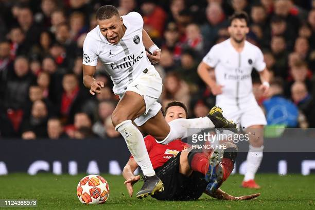 Manchester United's Spanish midfielder Ander Herrera fouls Paris SaintGermain's French striker Kylian Mbappe during the first leg of the UEFA...