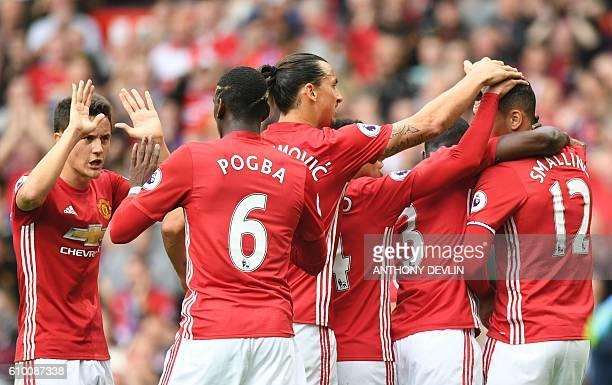 Manchester United's Spanish midfielder Ander Herrera Manchester United's French midfielder Paul Pogba and Manchester United's Swedish striker Zlatan...