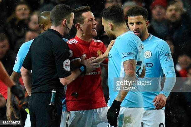 Manchester United's Spanish midfielder Ander Herrera remonstrates with Manchester City's Argentinian defender Nicolas Otamendi during the English...
