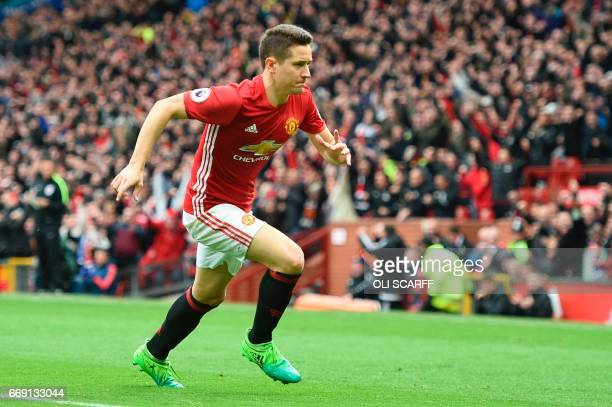 Manchester United's Spanish midfielder Ander Herrera runs to the corner to celebrate scoring their second goal during the English Premier League...