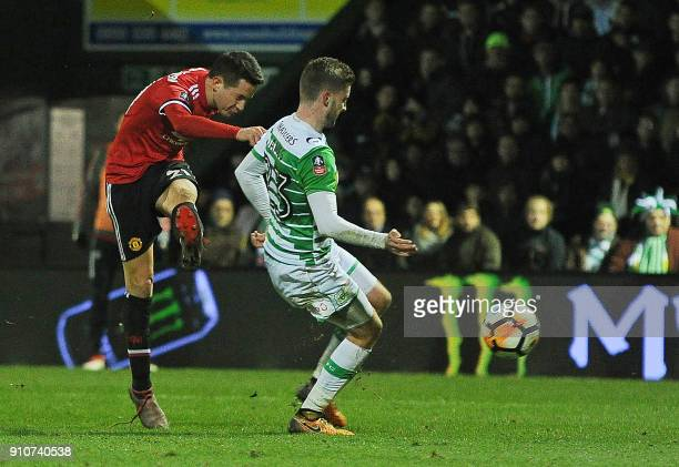 Manchester United's Spanish midfielder Ander Herrera scores the team's second goal during the FA Cup fourth round football match between Yeovil Town...