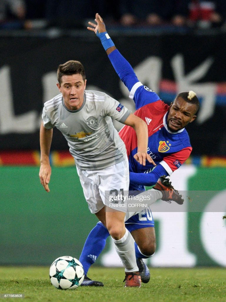Manchester United's Spanish midfielder Ander Herrera (L) vies with Basel's Ivorian midfielder Geoffroy Serey Die during the UEFA Champions League Group A football match between FC Basel and Manchester United on November 22, 2017 in Basel. / AFP PHOTO / Fabrice COFFRINI