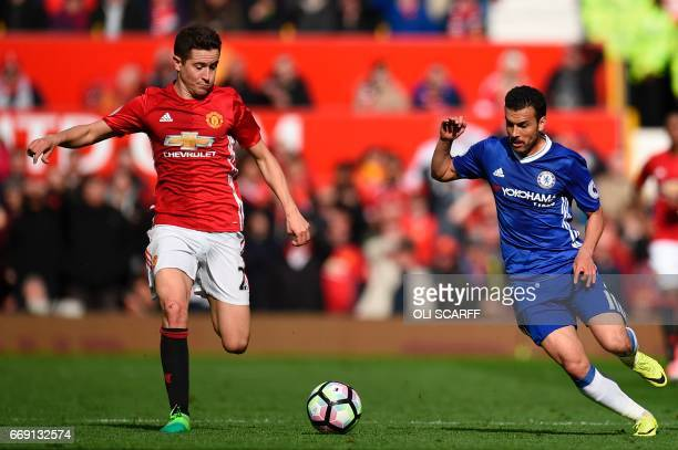Manchester United's Spanish midfielder Ander Herrera vies with Chelsea's Spanish midfielder Pedro during the English Premier League football match...
