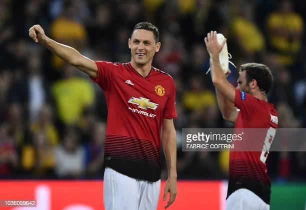 Manchester United's Spanish midfielder Juan Mata and teammate Manchester United's Serbian midfielder Nemanja Matic applaud their supporters after the...