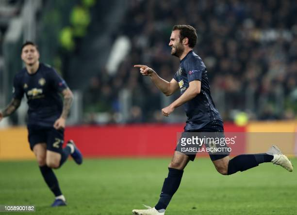Manchester United's Spanish midfielder Juan Mata celebrates after scoring a free kick equalizing during the UEFA Champions League group H football...