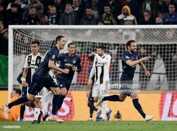 TOPSHOT Manchester United's Spanish midfielder Juan Mata celebrates after scoring a free kick equalizing during the UEFA Champions League group H...