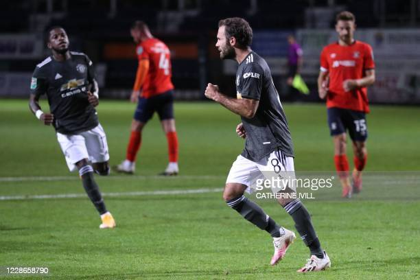 Manchester United's Spanish midfielder Juan Mata celebrates after he takes the penalty to score his team's first goal during the English League Cup...